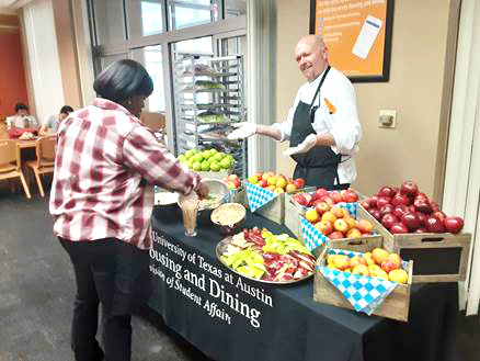 Chef John Huff presents a spread of apples as Kins Dining